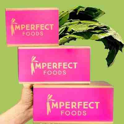imperfect food boxes green lettuce background (money)