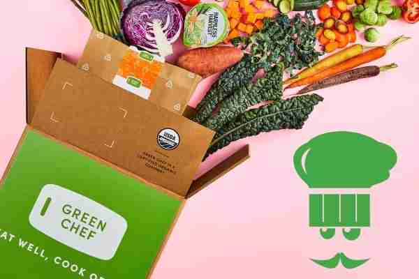 Green chef's delivered box pouring out with fresh produce